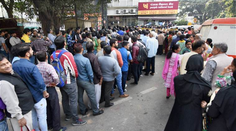 New Delhi: Demonetisation- People standing in long queues to exchange their old Rs 500 and 1000 notes and withdraw cash from the ATM in New Delhi on Thursday.PTI Photo by Subhav Shukla(PTI11_17_2016_000041B)