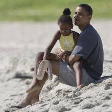 Obama playing with daughter